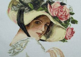 Girl in hat with rose