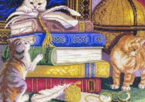 Kittens with books