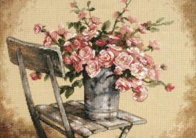 Roses on a white chair